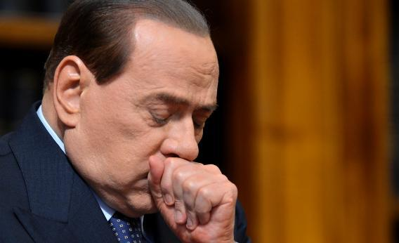 Former Italian Prime Minister Silvio Berlusconi reacts during a press conference on May 25, 2012, at the senate in Rome