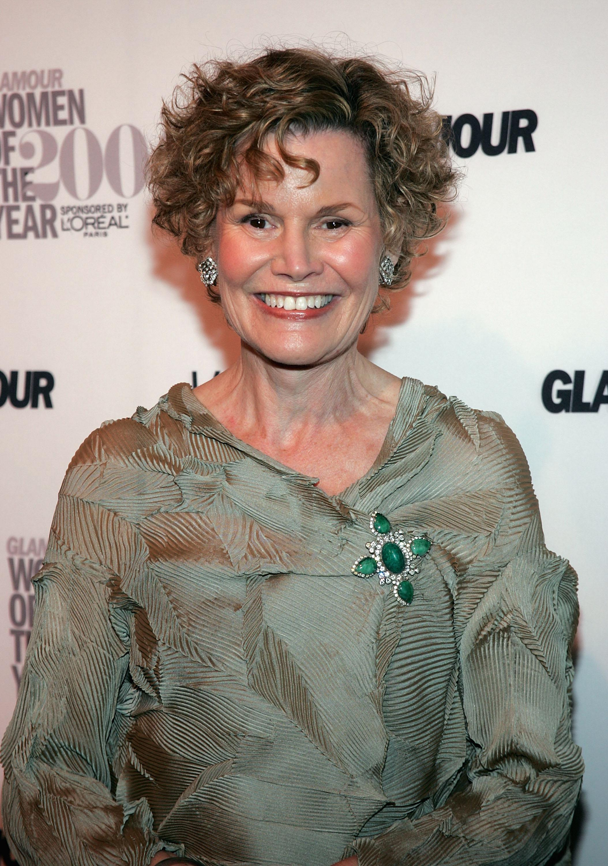 Judy Blume on a red carpet, smiling.