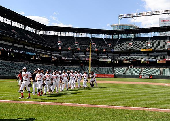The Baltimore Orioles celebrate after a 8-2 victory against the Chicago White Sox at Oriole Park at Camden Yards.