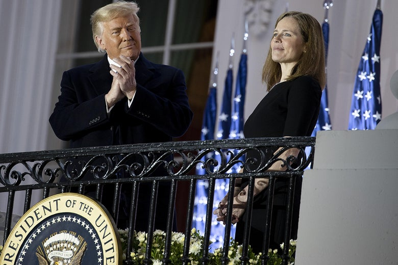 President Donald Trump stands with newly sworn in Supreme Court Associate Justice Amy Coney Barrett during a ceremonial swearing-in event on the South Lawn of the White House October 26, 2020 in Washington, D.C.