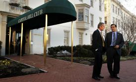 Rep. Darrell Issa (right) talks to Rep. Todd Akin, R.-Mo., outside the RNC headquarters in March 2011