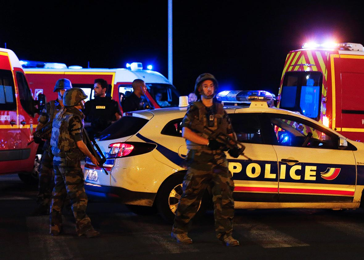 French soldiers and rescue forces are seen at the scene whare at least 30 people were killed in Nice, France, when a truck ran into a crowd celebrating the Bastille Day national holiday July 14, 2016.
