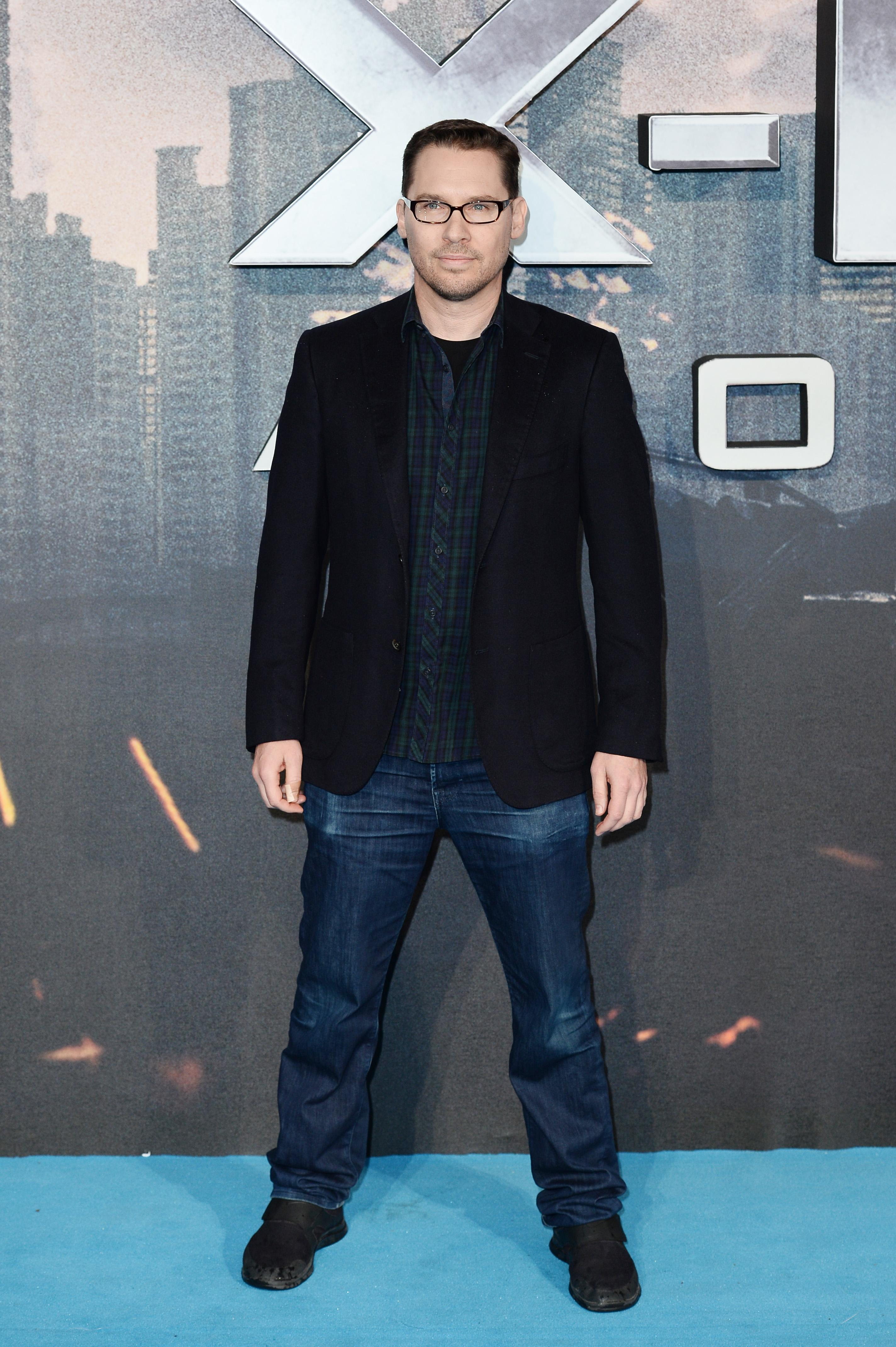 Man poses for photos at film premiere.