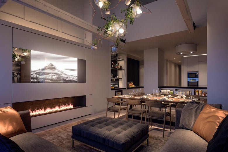 A fancy living and dining room with fireplace and chandelier