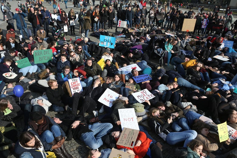 Demonstrators lay on the ground in protest at the March for Our Lives demonstration on March 24, 2018 in Berlin, Germany.