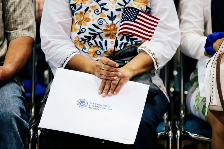 An attendee holds her flag and her naturalization papers as she is sworn in during a U.S. citizenship ceremony in Los Angeles on July 18.