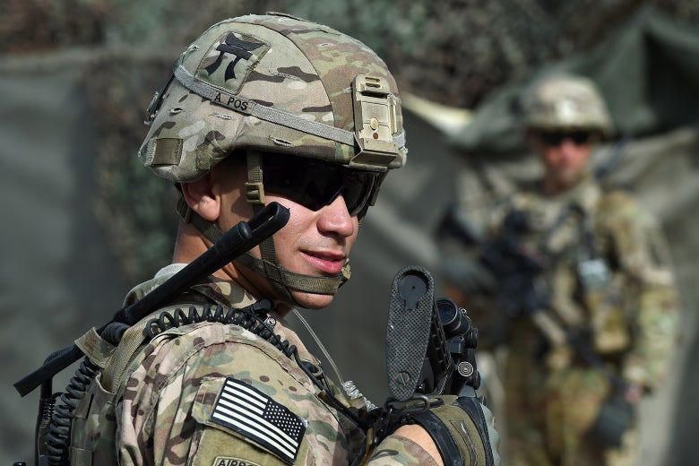 A U.S. army soldier stands guard at an Afghan National Army (ANA) base in the Khogyani district in the eastern province of Nangarhar on Aug. 12, 2015.