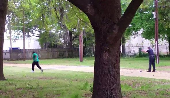 North Charleston police officer Michael Slager (R) is seen allegedly shooting 50-year-old Walter Scott.