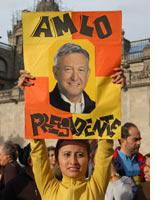 A supporter of López Obrador holds a sign declaring that he is president          Click image to expand