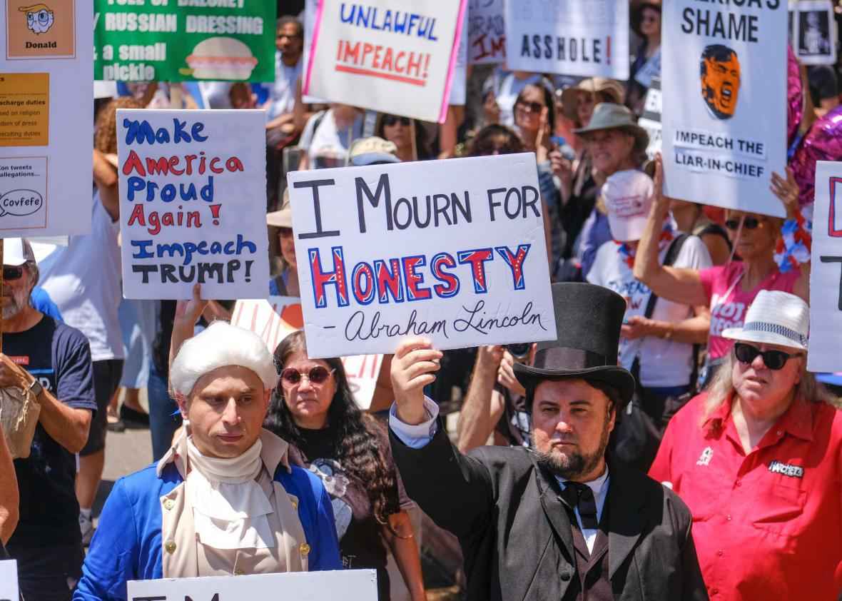 Thousands take part in marches across the country calling for Trump