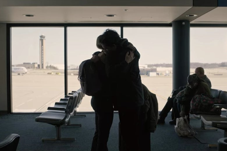 Bill and his daughter hugging in an airport.