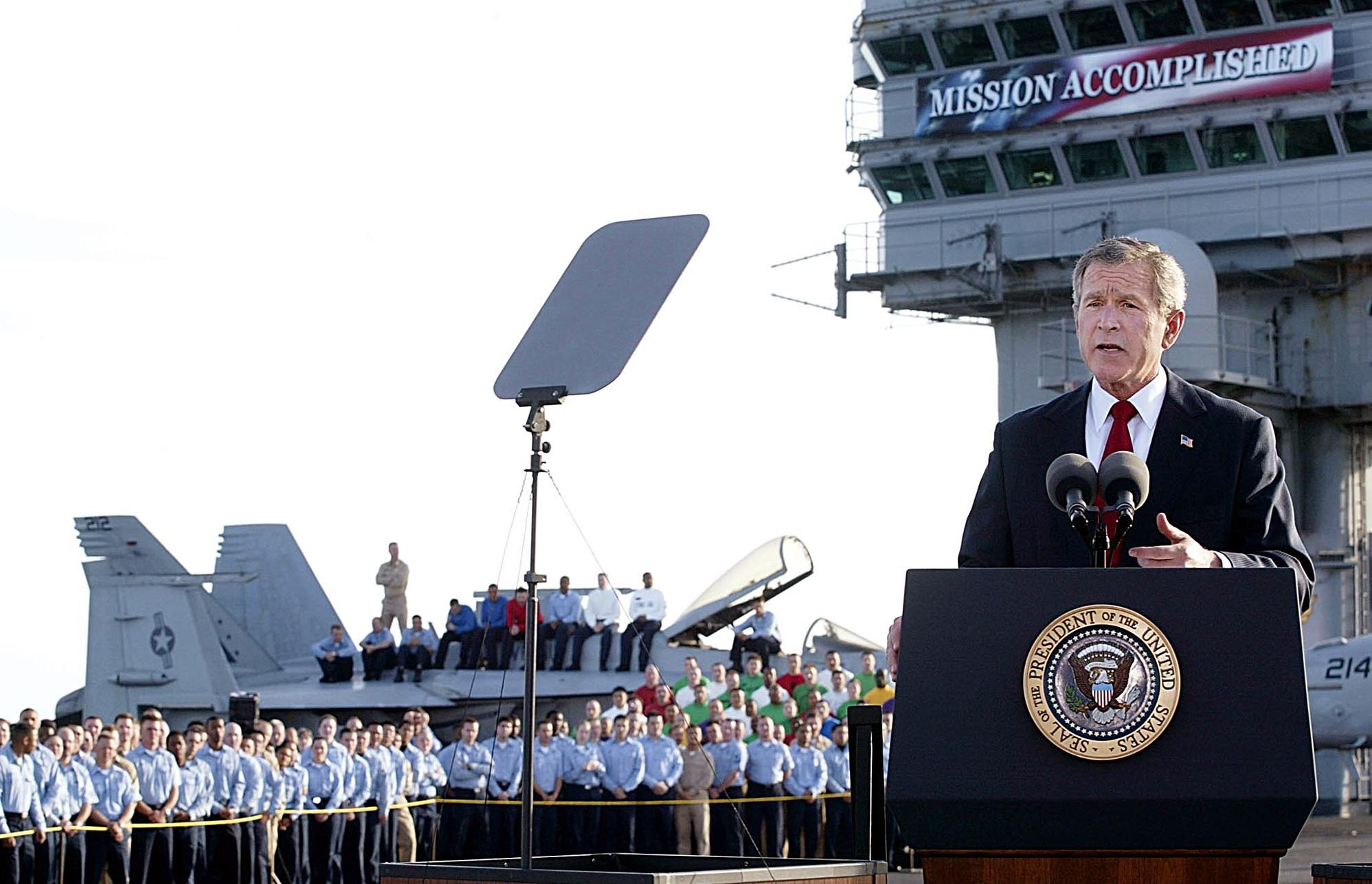 President George W. Bush addresses the nation aboard the nuclear aircraft carrier USS Abraham Lincoln on 1 May, 2003, as it sails for Naval Air Station North Island, San Diego, California.