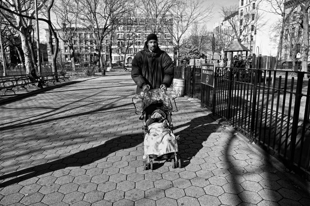 Harlem, NY. 2012. Guy MIller with son Guy Jr. at Marcus Garvey Park.
