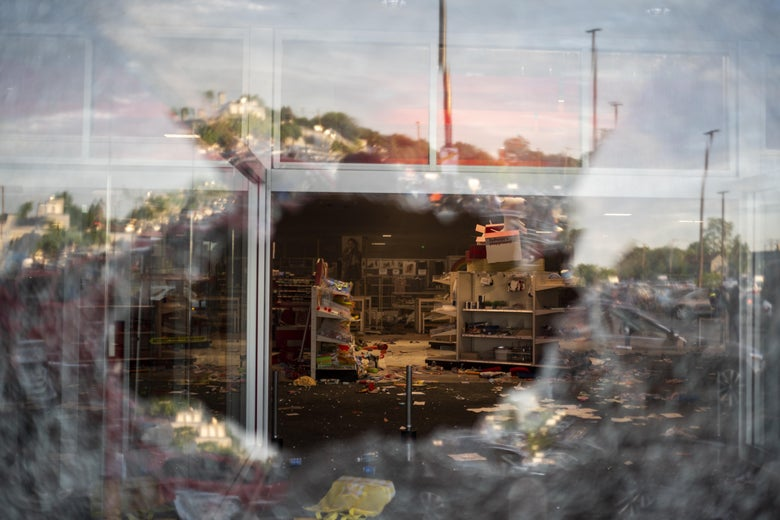 A view inside a Target store through a broken window.