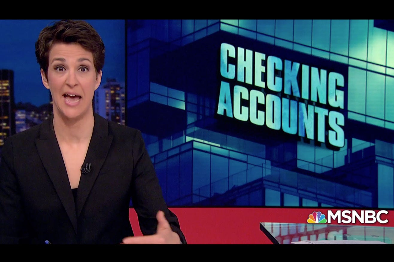 """Maddow on her show with the phrase """"Checking Accounts"""" on the screen."""