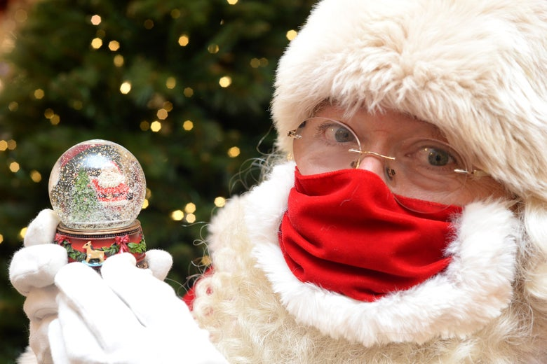 Santa Claus with a snow globe at Selfridges, Oxford Street on October 12, 2020 in London, England.