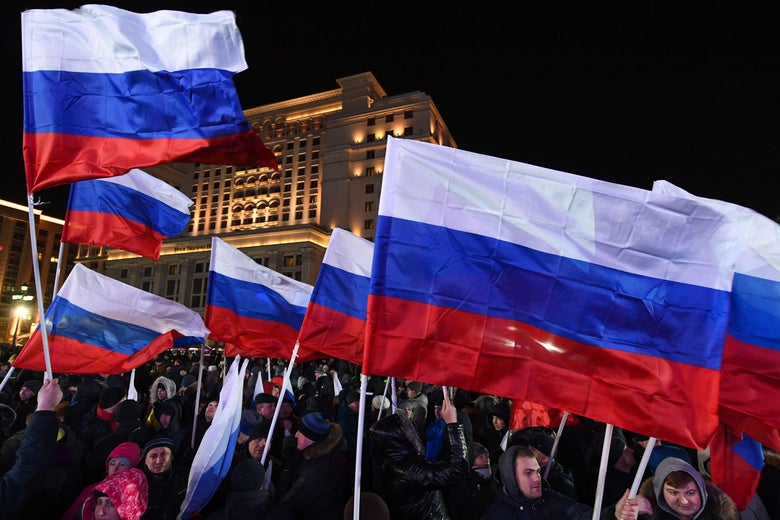 People holding Russian flags gather on Manezhnaya Square outside the Kremlin for a rally celebrating the fourth anniversary of Russia's annexation of Crimea in Moscow on March 18, 2018. / AFP PHOTO / Kirill KUDRYAVTSEV        (Photo credit should read KIRILL KUDRYAVTSEV/AFP/Getty Images)