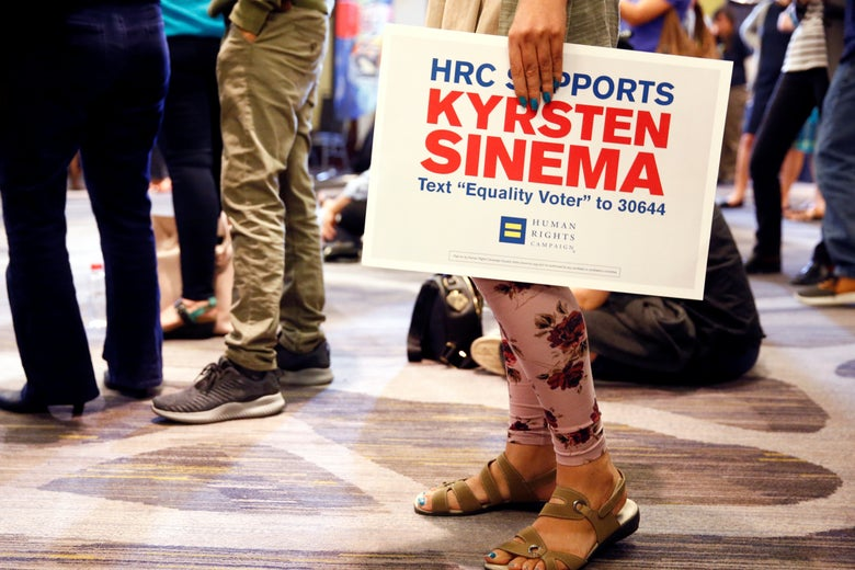 A supporter holds a sign for Kyrsten Sinema at the Arizona Democratic Party Election Night Party in Phoenix, Arizona, U.S. November 6, 2018.