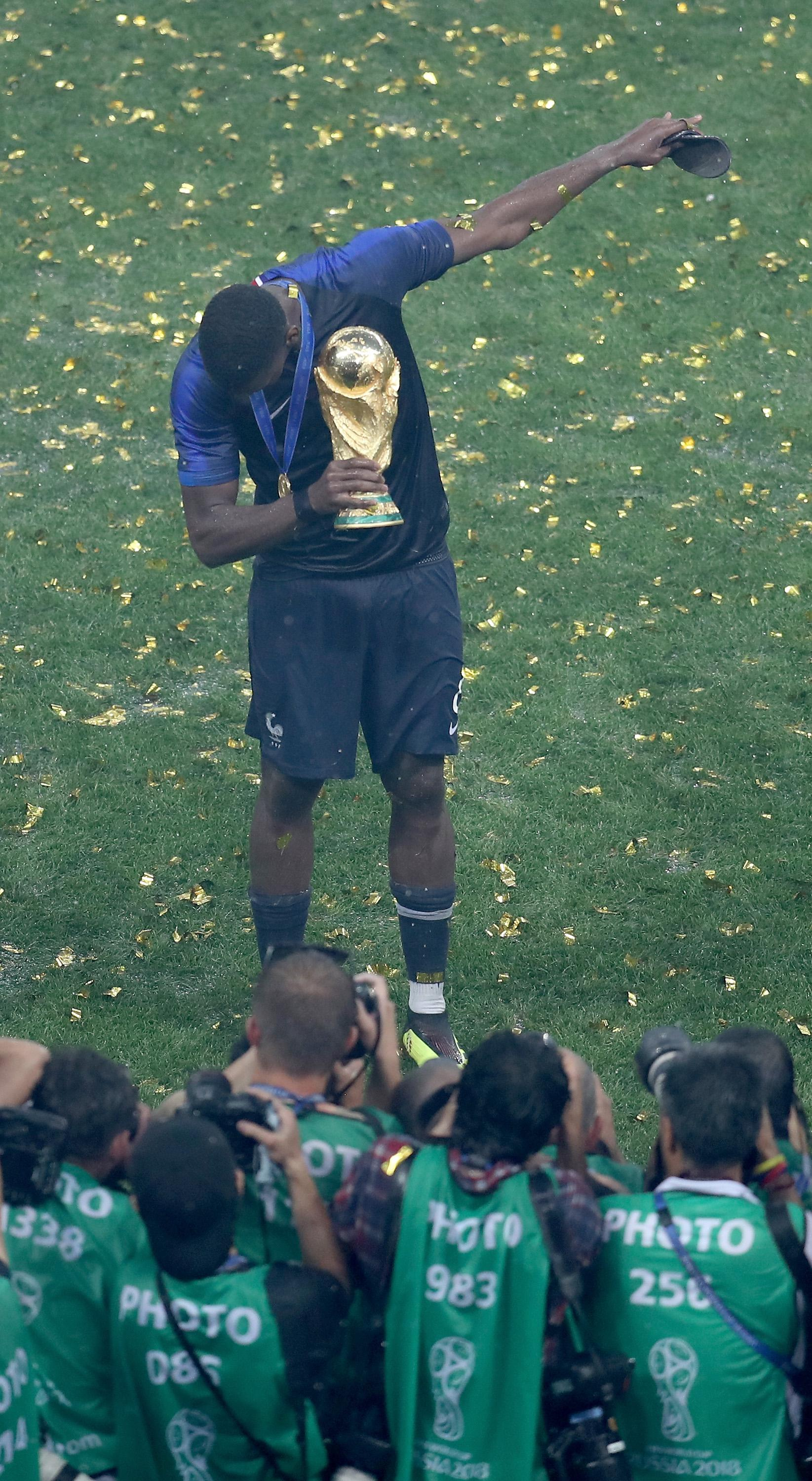 Paul Pogba of France celebrates with the World Cup Trophy on July 15, 2018 in Moscow, Russia.