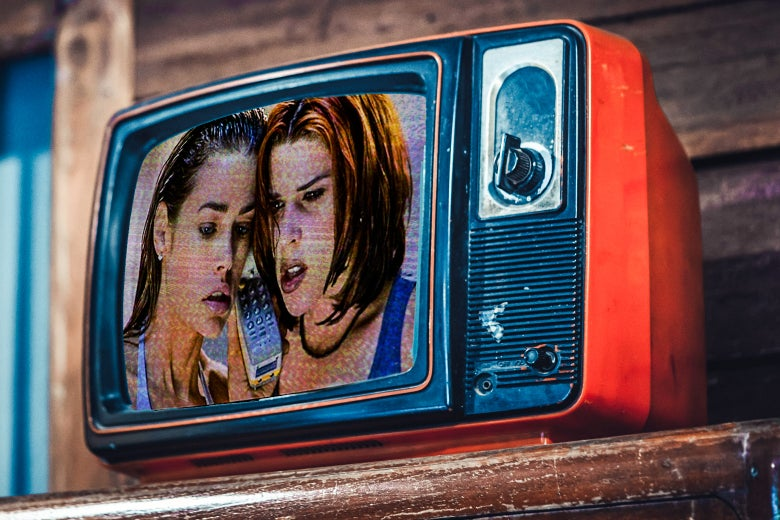 A photo illustrated still of Denise Richards and Neve Campbell in Wild Things, as seen in an old-fashioned TV.