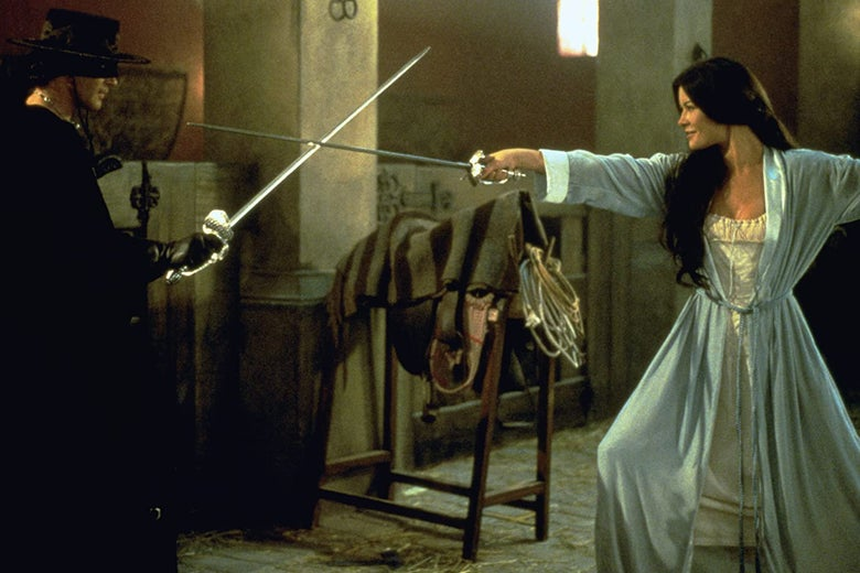 Antonio Banderas and Catherine Zeta-Jones spar with swords in early 19th century period clothing.