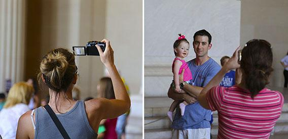 Tourists using their cameras in the Lincoln Memorial.