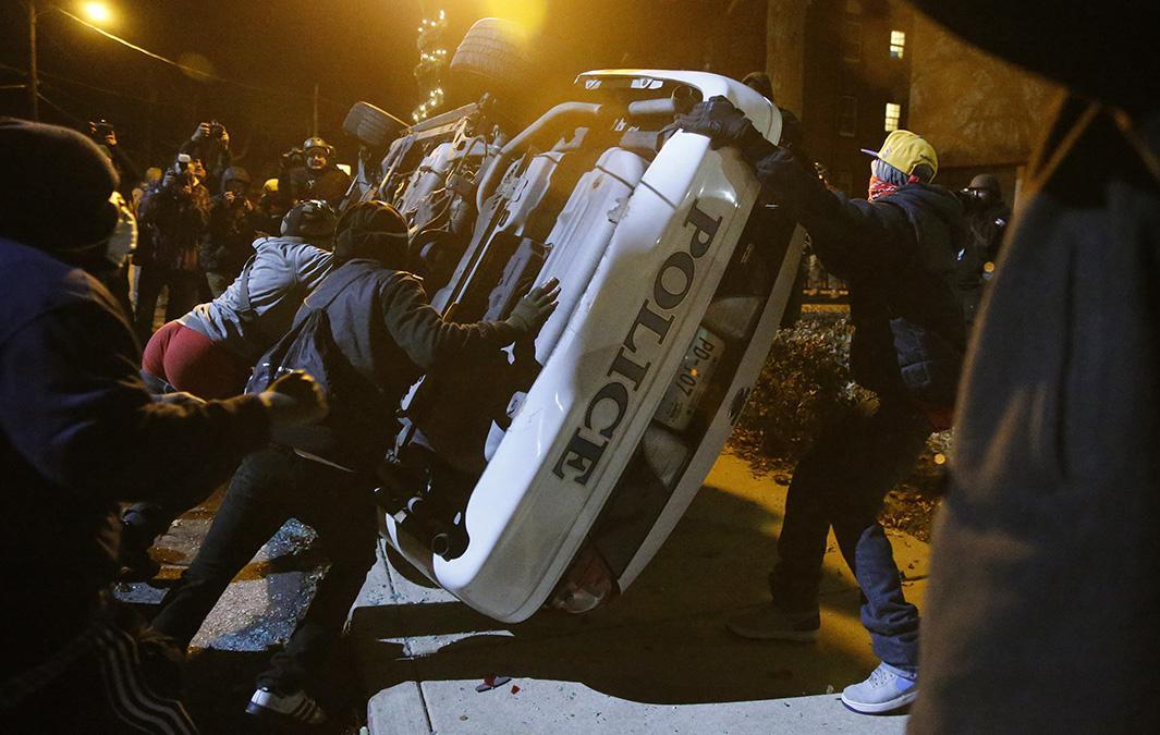ferguson protests photos police car.