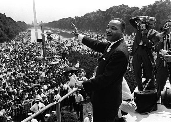 "Martin Luther King (C) waves to supporters on the Mall in Washington DC during the ""March on Washington"", August 1963."