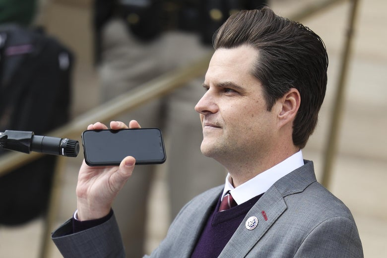 Rep. Matt Gaetz holds a phone to the microphone as Donald Trump Jr. speaks remotely to a crowd during a rally against Rep. Liz Cheney (R-WY) on January 28, 2021 in Cheyenne, Wyoming.