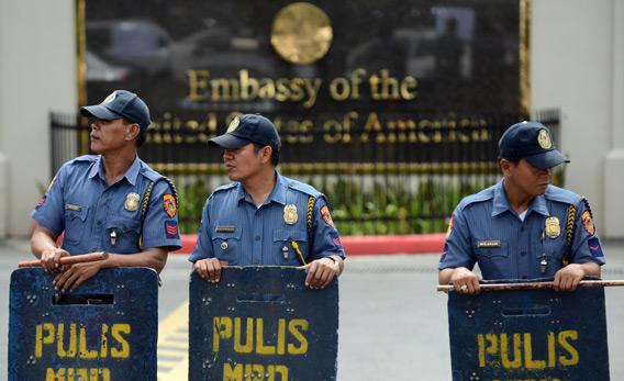 Philippine policemen stand guard in front of the US embassy in Manila.