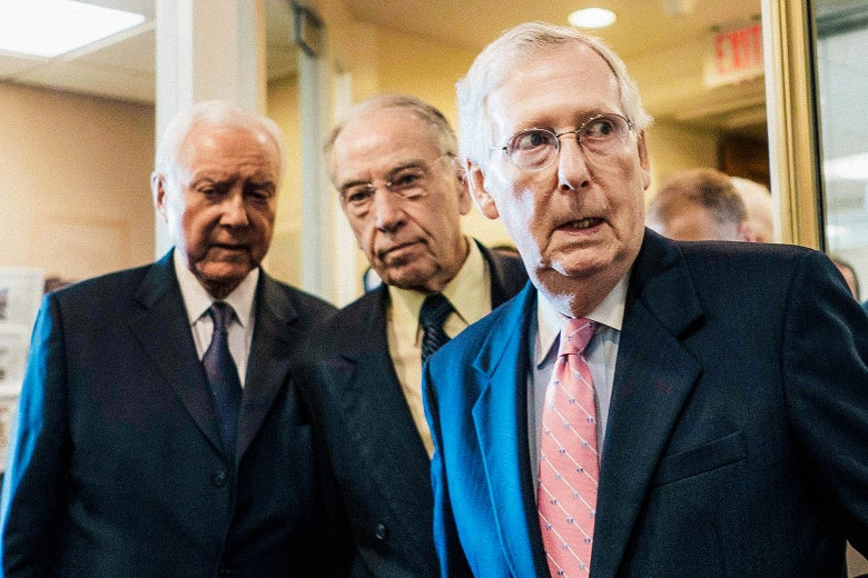 Hatch, Grassley, and McConnell pictured before beginning a press conference.