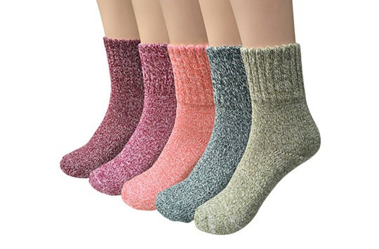 Five multi-colored wool socks.