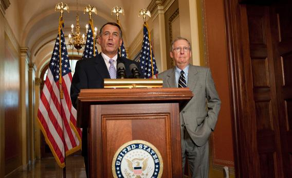 US Speaker of the House John Boehner and US Senate Minority Leader Mitch McConnell hold a press conference on July 30, 2011 at the US Capitol in Washington, DC.
