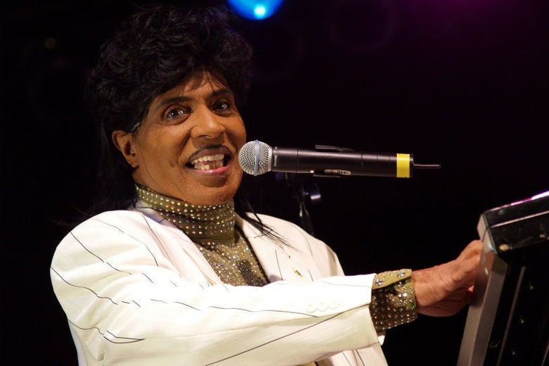 Little Richard at a microphone