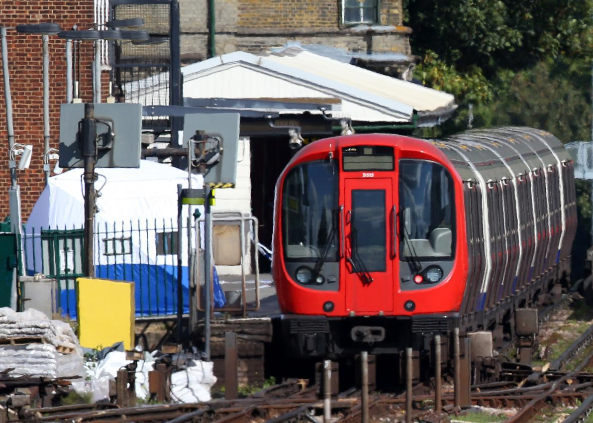 A forensic tent is seen next to the stopped tube train at Parsons Green Underground Station on Friday in London. & London Underground bombing injures several