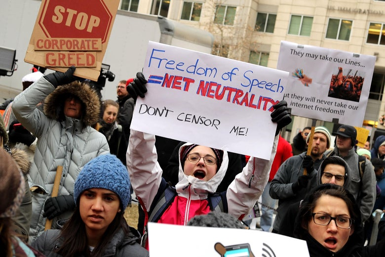 Demonstrators rally outside the Federal Communication Commission building to protest against the end of net neutralityrules December 14, 2017 in Washington, D.C.