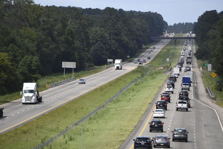 Residents drive north on Interstate Highway 55 near Magnolia, Mississippi, as they evacuate away from New Orleans on August 28, 2021, before the arrival of Hurricane Ida.