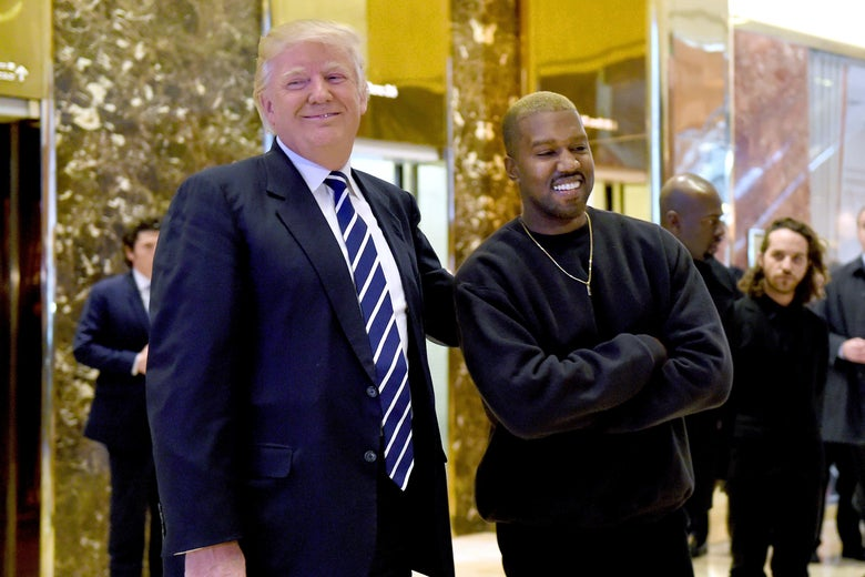 Donald Trump and Kanye West pose for a photo in the lobby of Trump Tower.