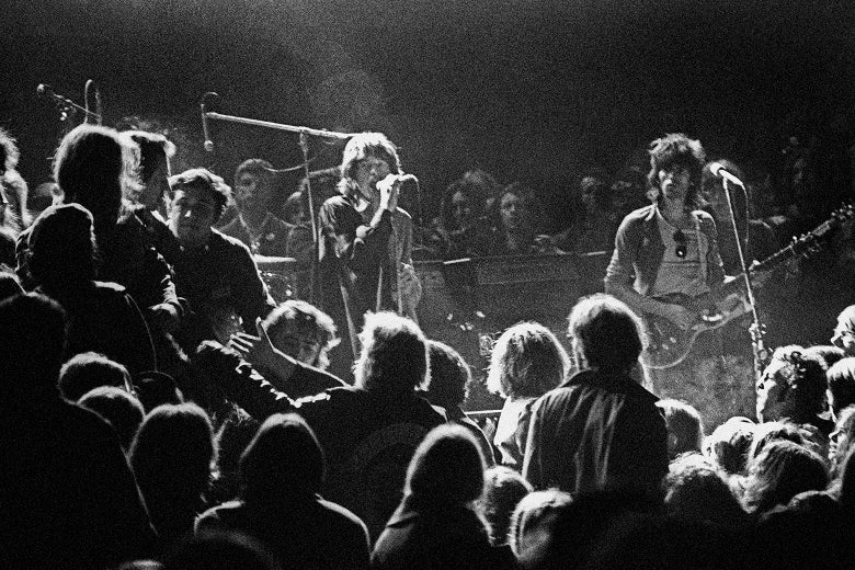 Mick Jagger and Keith Richards of the Rolling Stones eye the Hell's Angels onstage at the Altamont Speedway on Dec. 6, 1969 in Livermore, California.