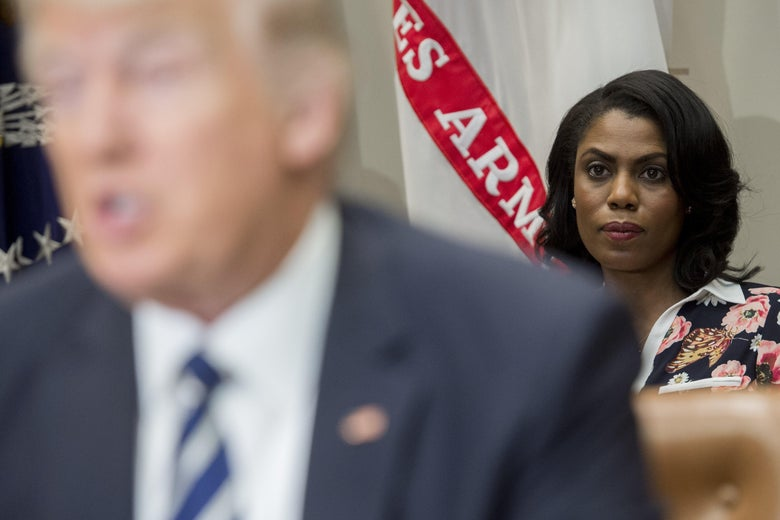 Omarosa Manigault sits behind President Donald Trump as he speaks during a meeting with teachers, school administrators and parents in the Roosevelt Room of the White House in Washington, D.C. on February 14, 2017.
