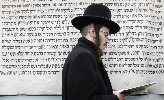 Hasidic Jew prays in a small town in Poland.