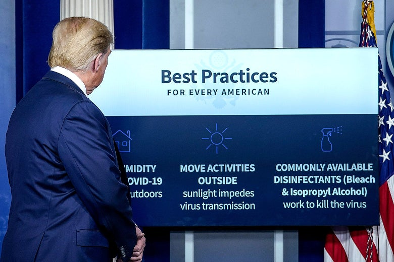 "Donald Trump looks at a board behind him that says ""Best Practices for Every American."""