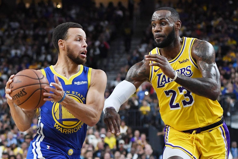 Stephen Curry drives against LeBron James, in a Lakers jersey.