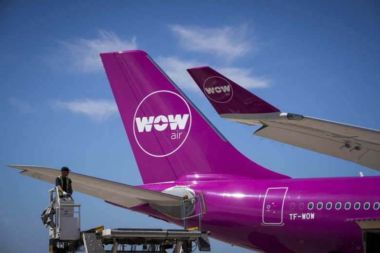 A bright pink Wow plane on the tarmac.