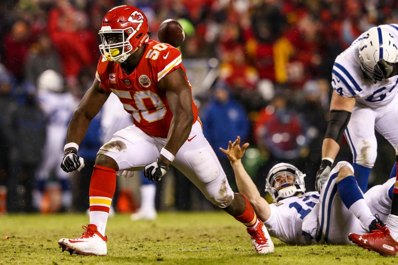 KANSAS CITY, MO - JANUARY 12: Andrew Luck #12 of the Indianapolis Colts tosses the ball after being sacked by Justin Houston #50 of the Kansas City Chiefs during the third quarter of the AFC Divisional Round playoff game at Arrowhead Stadium on January 12, 2019 in Kansas City, Missouri. (Photo by Jamie Squire/Getty Images)