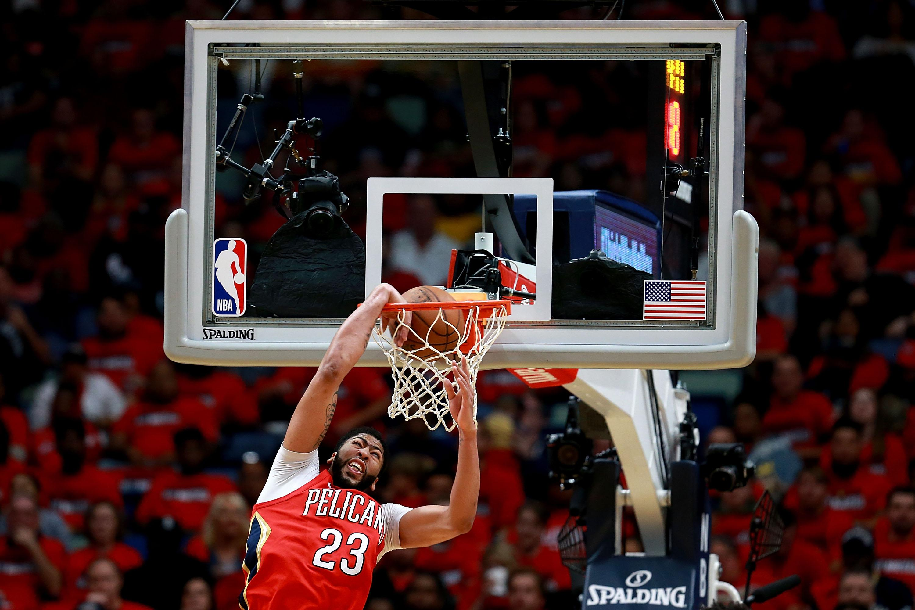 NEW ORLEANS, LA - APRIL 19:  Anthony Davis #23 of the New Orleans Pelicans dunks the ball during Game 3 of the Western Conference playoffs against the Portland Trail Blazers at the Smoothie King Center on April 19, 2018 in New Orleans, Louisiana. NOTE TO USER: User expressly acknowledges and agrees that, by downloading and or using this photograph, User is consenting to the terms and conditions of the Getty Images License Agreement.  (Photo by Sean Gardner/Getty Images)