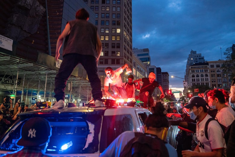 Protesters vandalize a police cruiser in Union Square on May 30, 2020 in New York City.