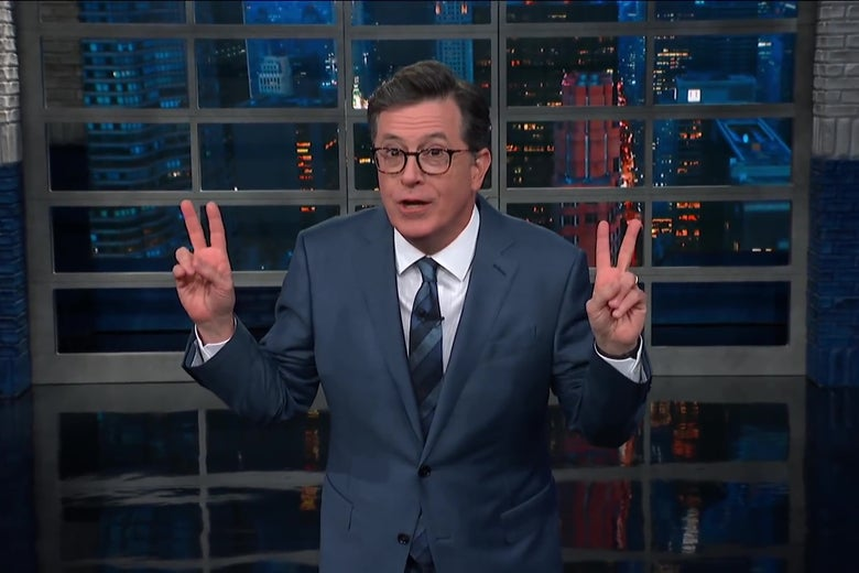 Stephen Colbert, making Richard Nixon's victory gesture.