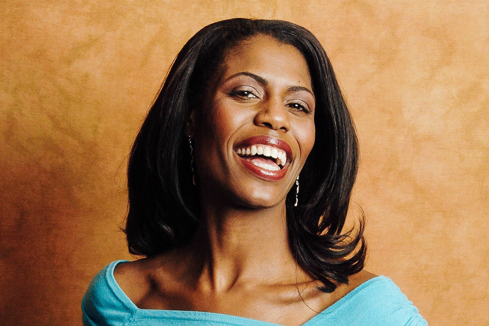 Omarosa smiling broadly.