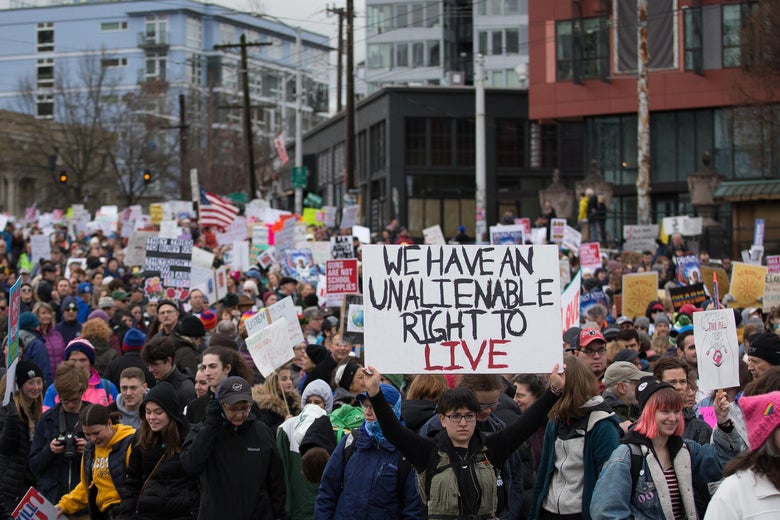 Thousands of people march down Pine Street towards downtown Seattle during the March for Our Lives rally on March 24, 2018 in Seattle, Washington.